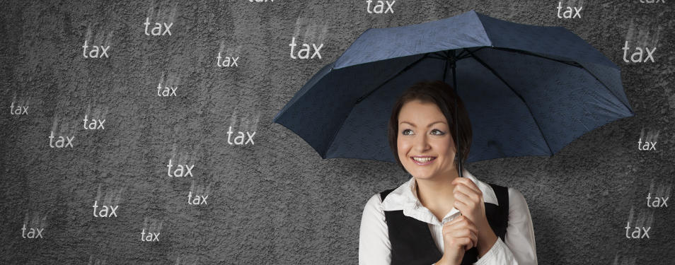 A woman holds an umbrella with the word tax falling around her